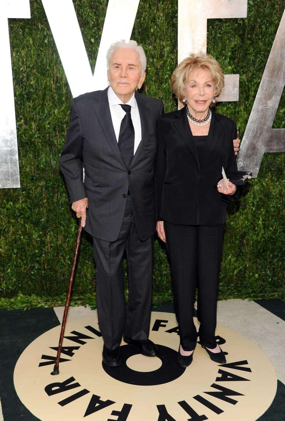 Douglas and his wife, Anne, arrive at the