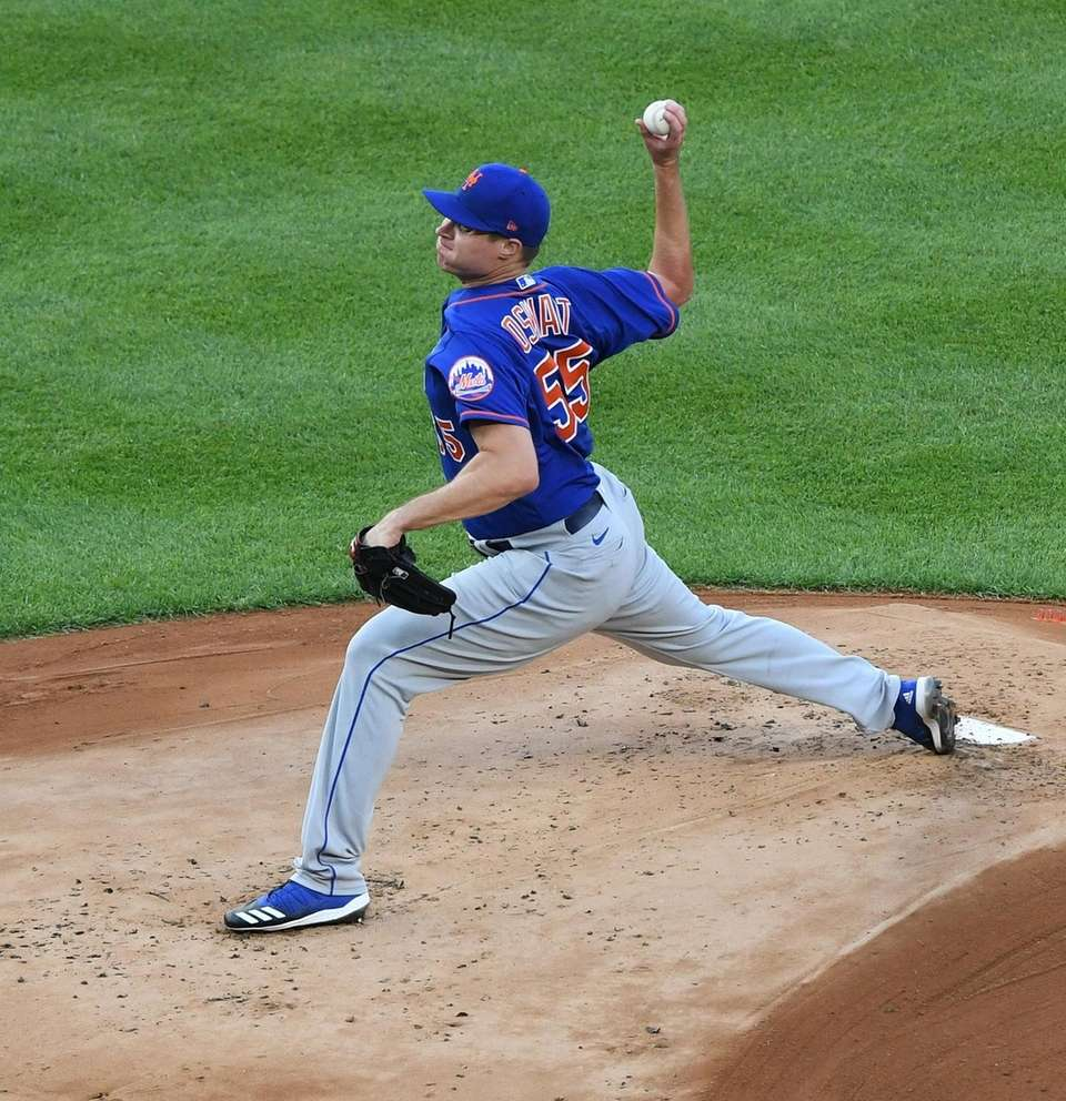 New York Mets pitcher Corey Oswalt delivers against