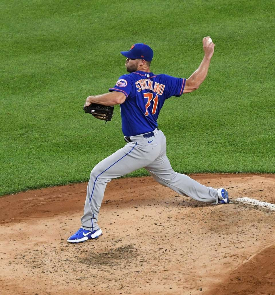 New York Mets pitcher Hunter Strickland delivers against