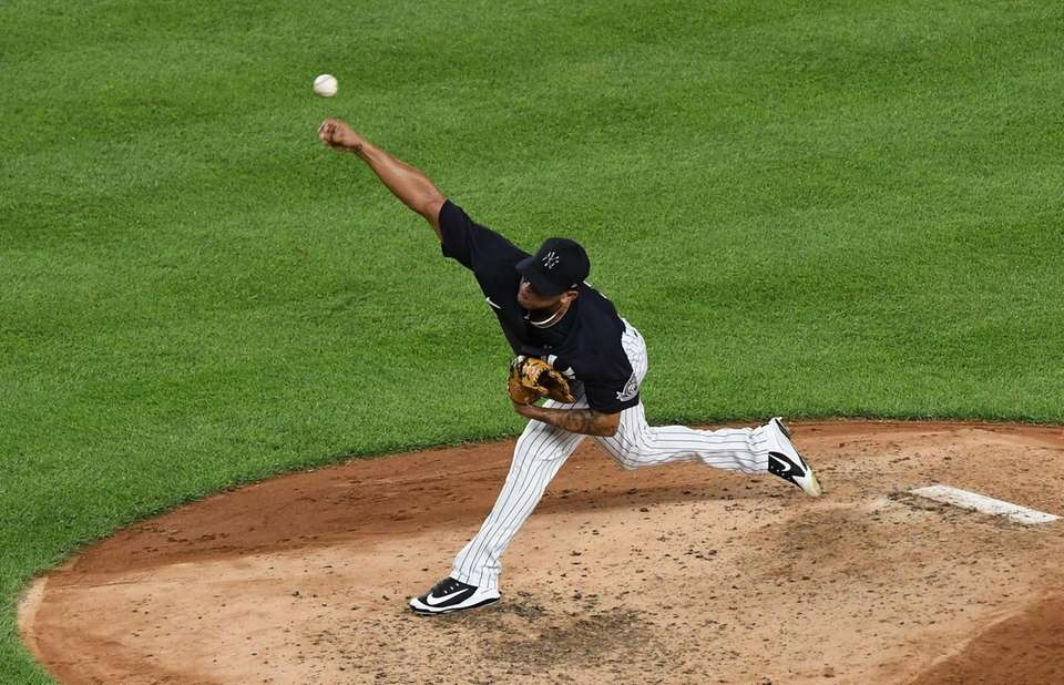 New York Yankees pitcher Jonathan Loaisiga delivers against