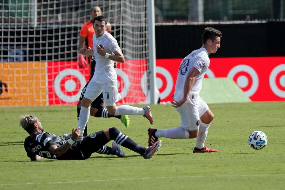 Inter Miami defender Dylan Nealis, right, clears the