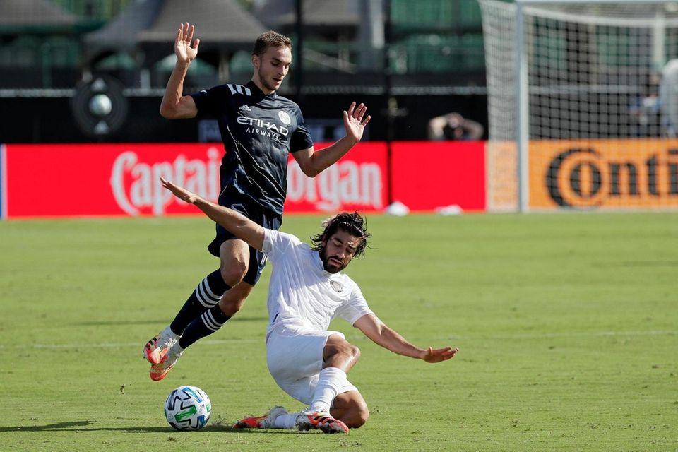 New York City FC midfielder James Sands, left,