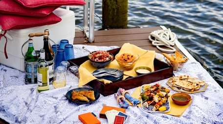A dockside picnic at Conscience Bay in Port