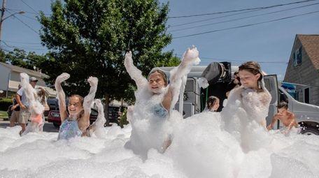 Giuliana Cirotti plays in a foam pit at