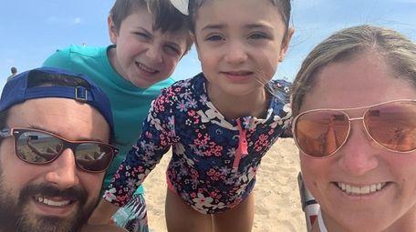 Dad Derek, Austin and Madison, 4, and Katie