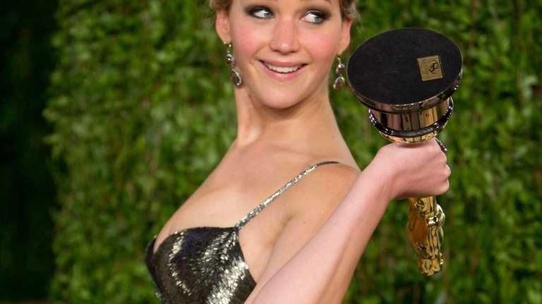 Jennifer Lawrence, carrying her Oscar for best actress,