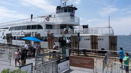 Passengers board a ferry to Liberty Island on