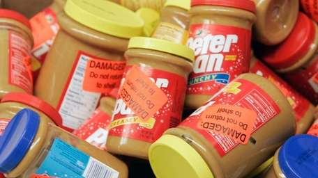 Returned jars of Peter Pan Peanut Butter are
