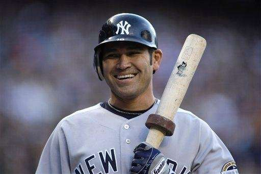 Johnny Damon prepares for an at-bat during a