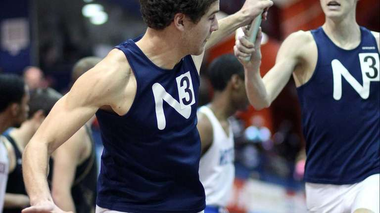 Northport's James Dickinson hands off to Dan Thorn