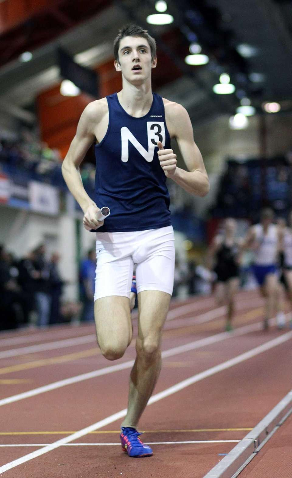 Northport's James Dickinson runs the first leg of