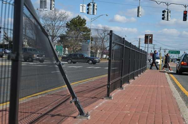Pedestrians cross Hempstead Turnpike in East Meadow, where