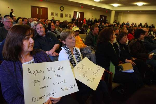 Pam Dempsey and Lori Stehl, holding signs from