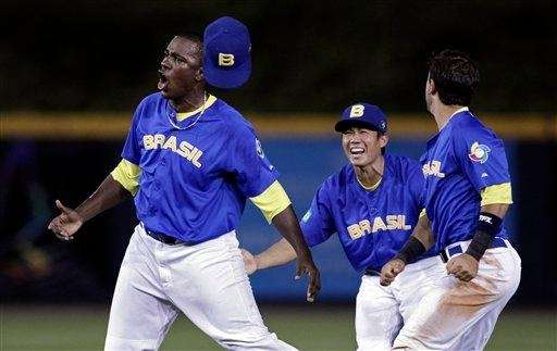 ??Brazil's pitcher Thyago Vieira, left, celebrates with teammates