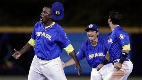 ??Brazil's pitcher Thyago Vieira, left, celebrates with teammates