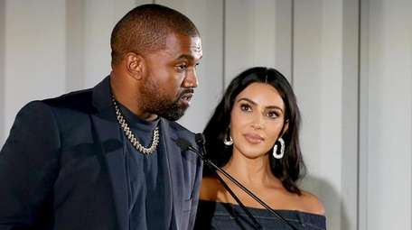 Kanye West and Kim Kardashian West speak onstage