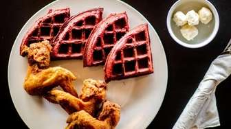 Fried chicken with red velvet waffles served with