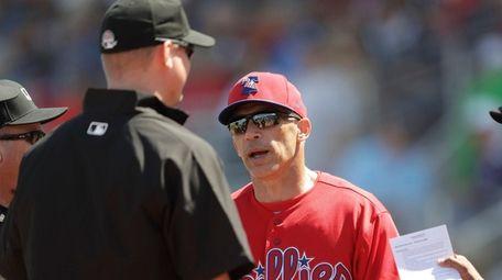 Philadelphia Phillies manager Joe Girardi speaks to the