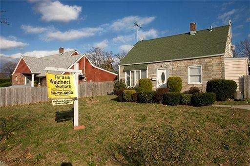 A home in Levittown has a for-sale sign.