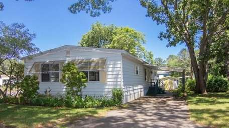 This 1,440-square-foot three-bedroom, two-bath mobile home in Riverhead
