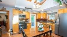 The kitchen is bright, with skylights.