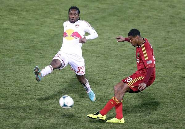 Chris Schuler of Real Salt Lake, right, shoots