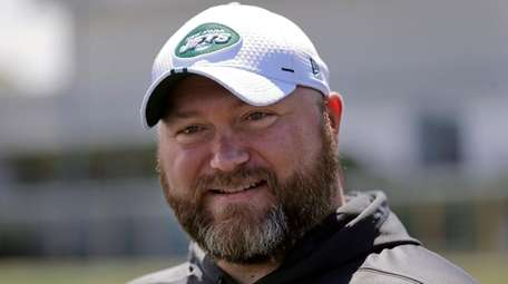 Jets general manager Joe Douglas greets reporters during