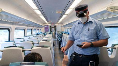 A Long Island Rail Road employee takes a