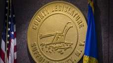 The Suffolk County Legislature medallion hangs on the