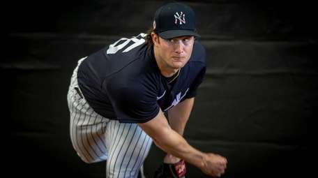 New York Yankees' pitcher Gerrit Cole throwing in