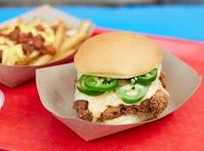 A fried chicken slider with pepper Jack cheese,