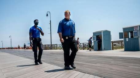 Long Beach police patrol the city's boardwalk on