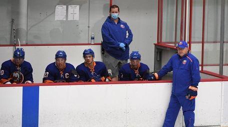 Islanders head coach Barry Trotz, on the ice,
