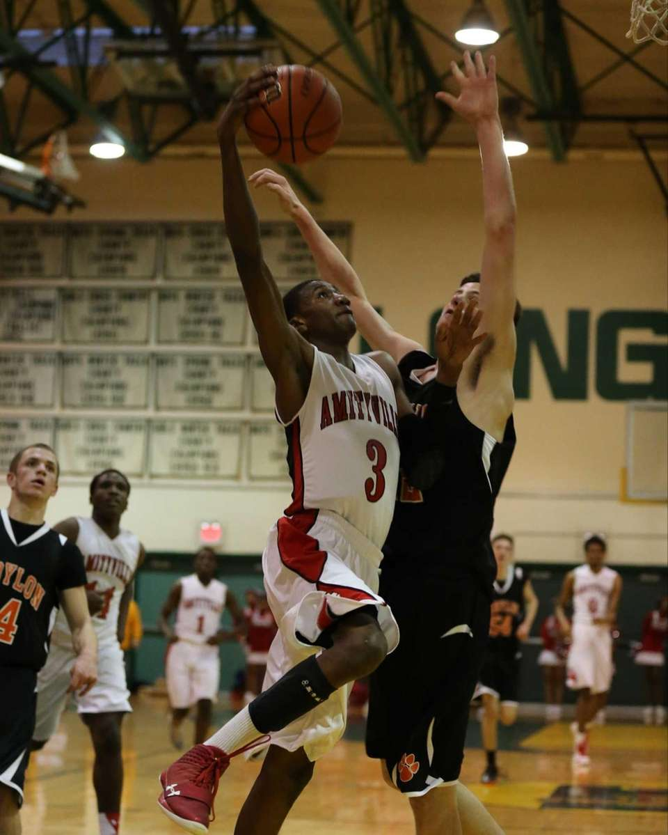 Amityville's Travis Dickerson goes up for the shot