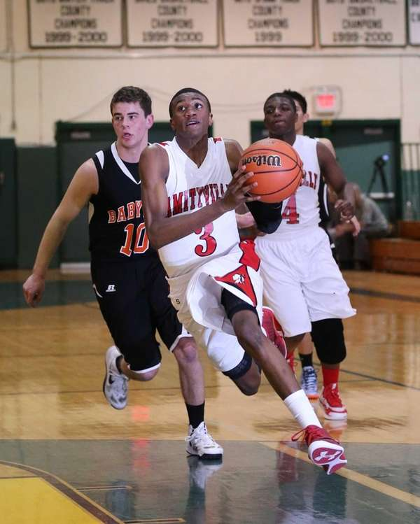 Amityville's Travis Dickerson drives toward the basket past