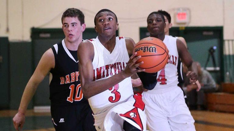 Amityville's Travis Dickerson drives toward the basket past