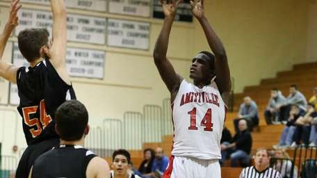 Amityville's Kavione Green sinks a basket in the