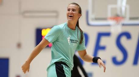 Sabrina Ionescu of the Liberty smiles during practice
