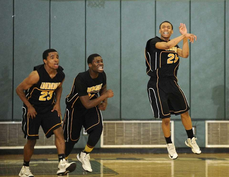 Uniondale players including Jerel McGary, left, and Aaron