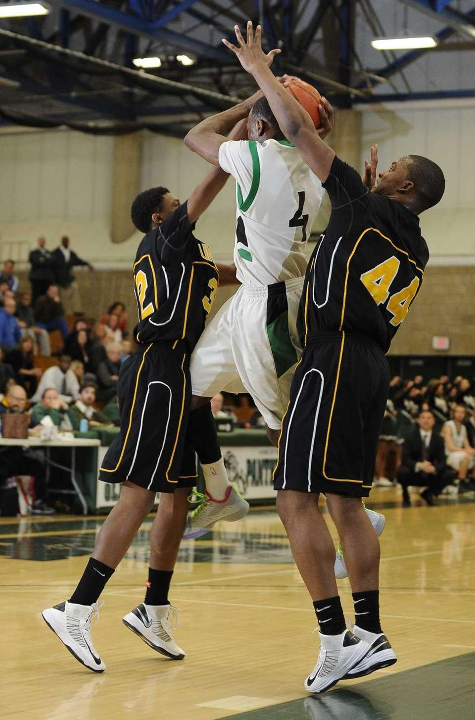 Uniondale's Jaaz Styles, left, and Tyler Desire guard