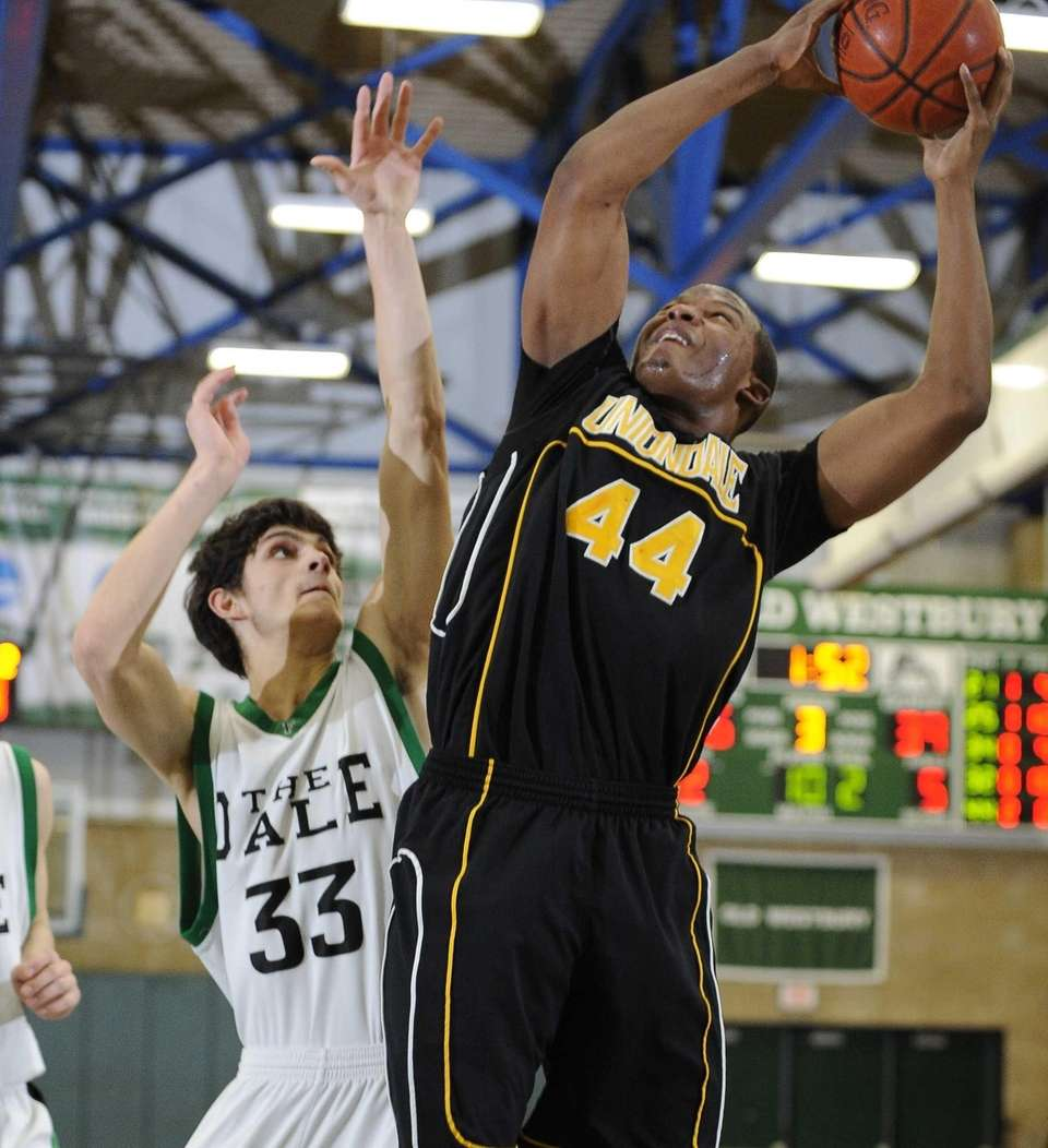 Uniondale's Tyler Desire scores and is fouled by