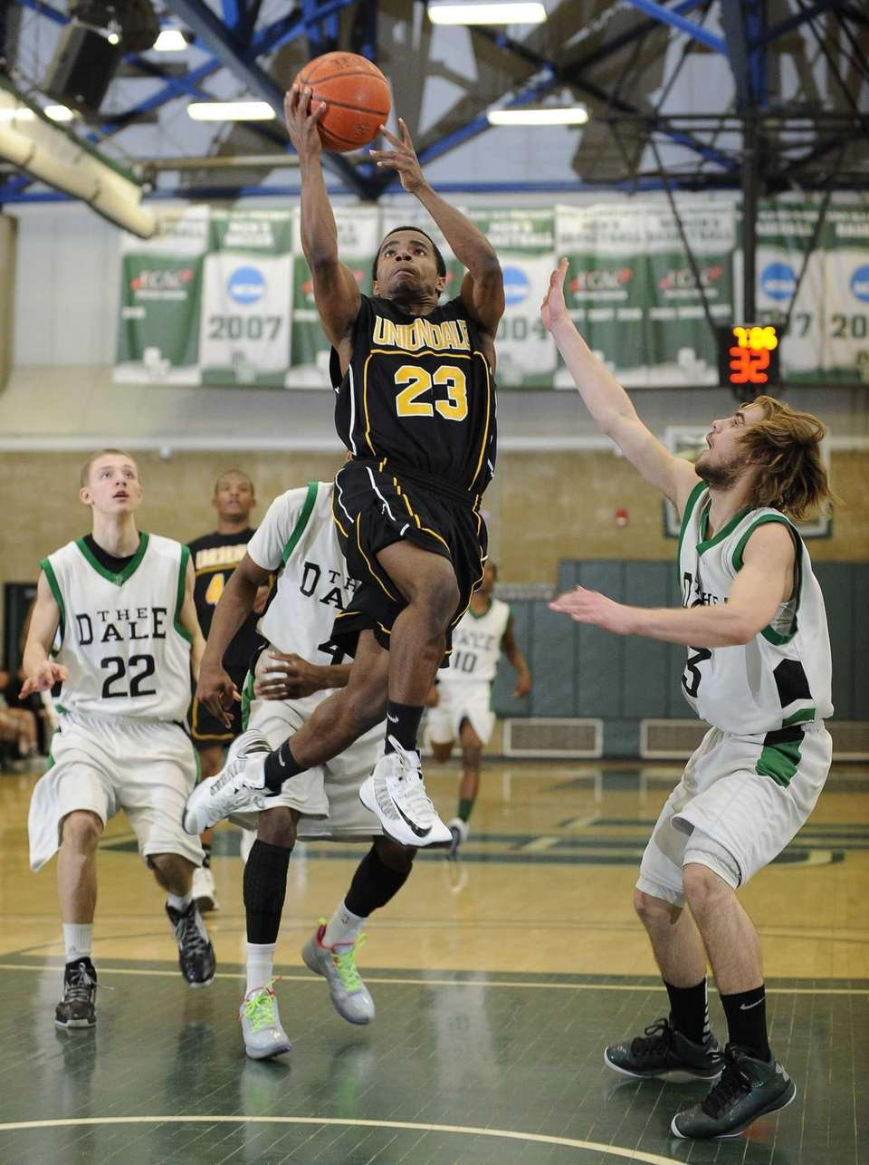 Uniondale's Jerel McGary scores against Farmingdale in the