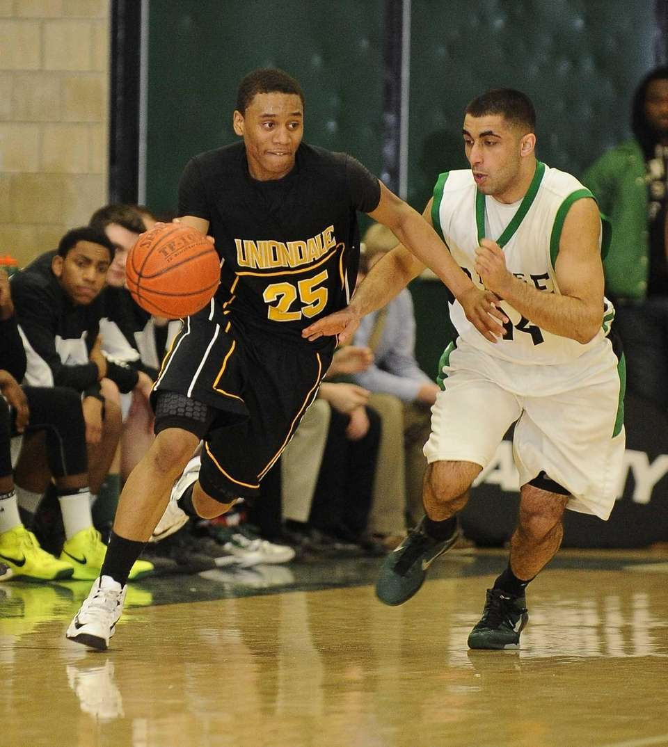 Uniondale's Aaron Cust drives the ball while being