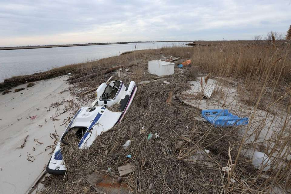 Debris, including a water scooter, washed up along