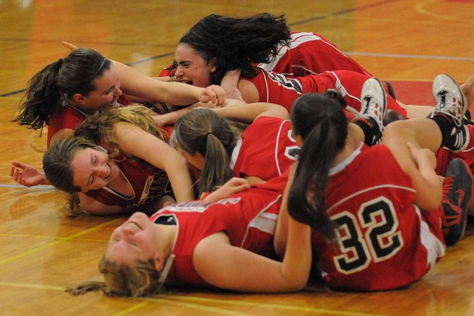 Floral Park's Lindsey Tanalski, top, and teammates celebrate