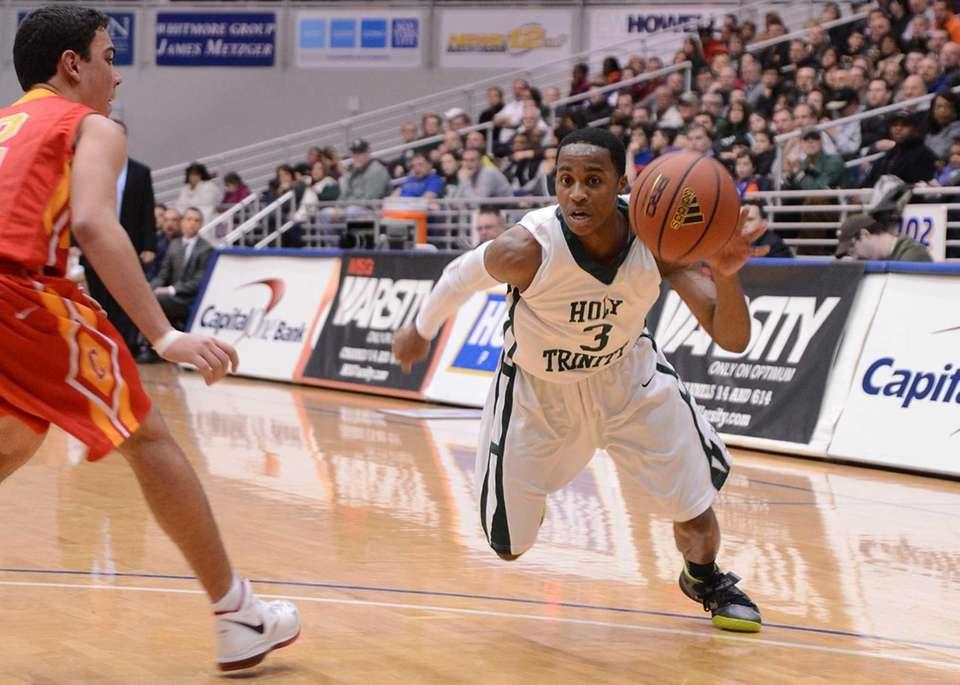 Holy Trinity's Damon Coleman drives hard to the