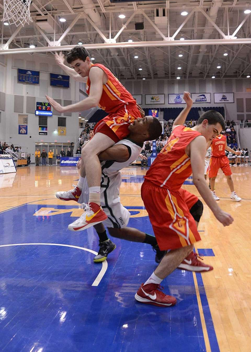Holy Trinity's Richard McEachen is fouled by Chaminade's