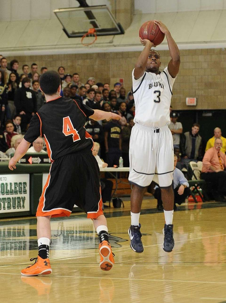 Baldwin's Travais Hylton shoots against Hicksville in the