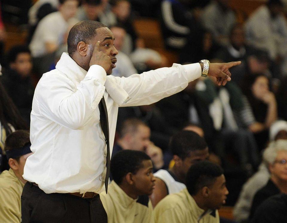 Baldwin head coach Darius Burton reacts during action