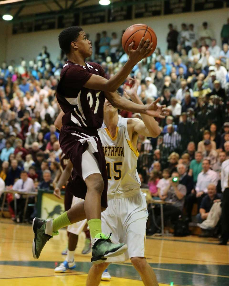 Deer Park's Denzell Etienne drives to the basket